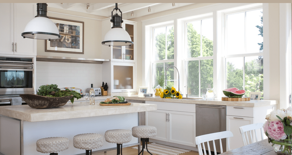 White Kitchens white farmhouse sink This White Kitchen Was Designed For Style Comfort Custom Sewn Seat Covers Turn These Cork Screw Stools Into Inviting Places To Plop And Chat With The